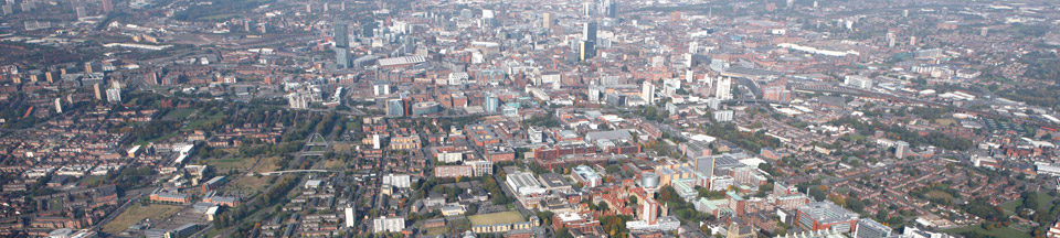 A birds-eye view photograph of buildings in the area of South Manchester.