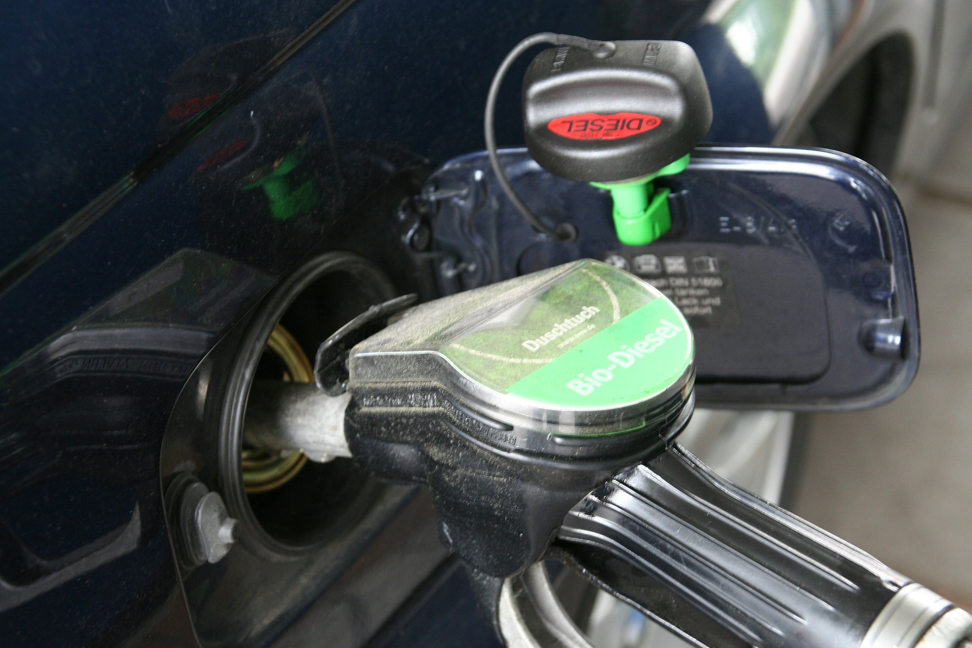 A picture of a car being filled up with fuel