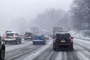 A picture of cars driving in snow