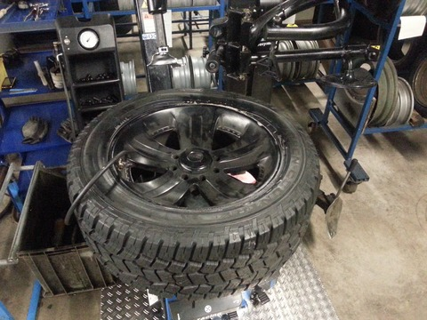 A picture of a tyre being serviced for tyre maintenance