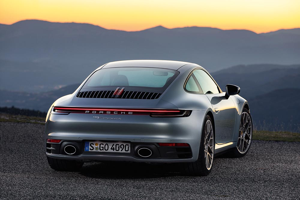 an image of a grey Porsche 911 Carrera from behind