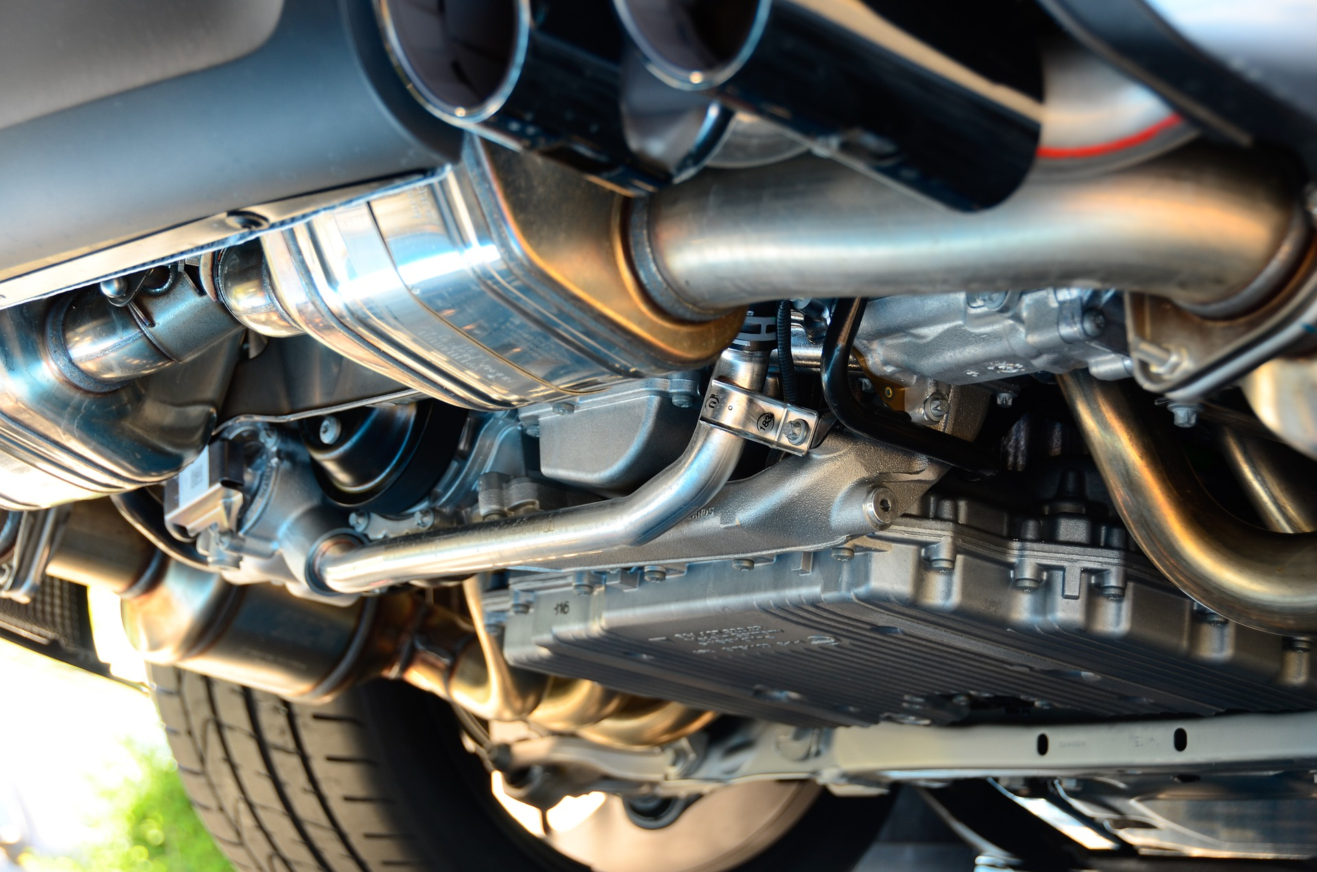 An image of the underside of a car, showing the exhaust.